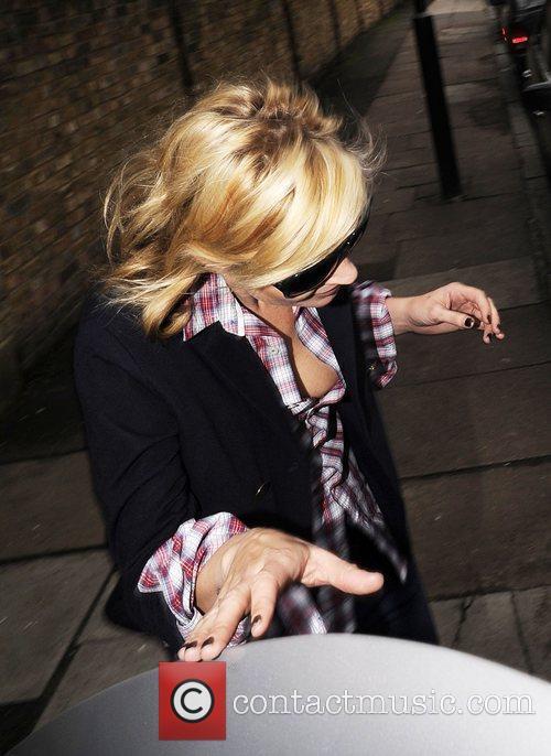 Kate Moss suffers an embarrassing wardrobe malfunction as...