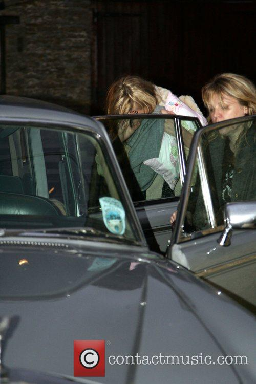 Kate Moss leaves the Swann Inn with her...