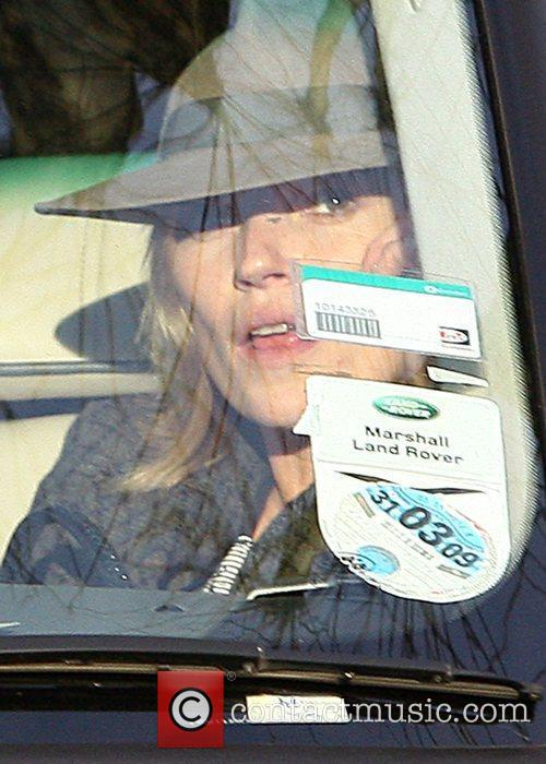 Kate Moss  sits in her car after...