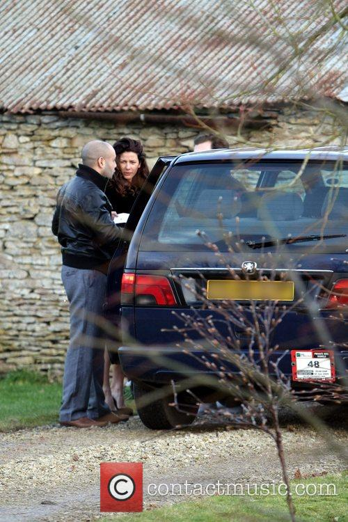 A guest leaves Kate Moss' house in the...
