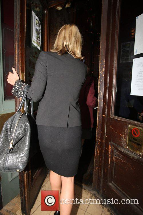 Kate Moss arriving at a pub after filming...