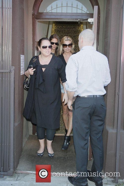 Kate Moss leaving Decades and Decadestwo boutique on...