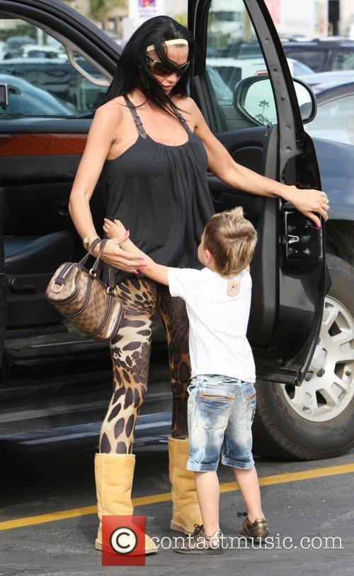 Katie Price, Junior go for lunch at Gladstones 4 Fish. Katie appears to be wearing a pair of Ugg boots, leopard print leggings.