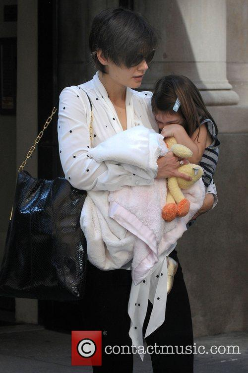 Katie Holmes leaving her apartment with her daughter...
