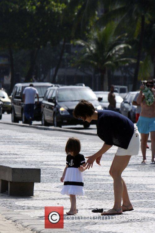 Walking with her daughter Suri on Copacabana Beach.