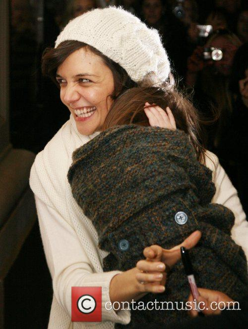 Katie Holmes leaves her Manhattan apartment with her...