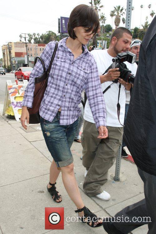 Katie Holmes leaving a publishing building on Sunset...