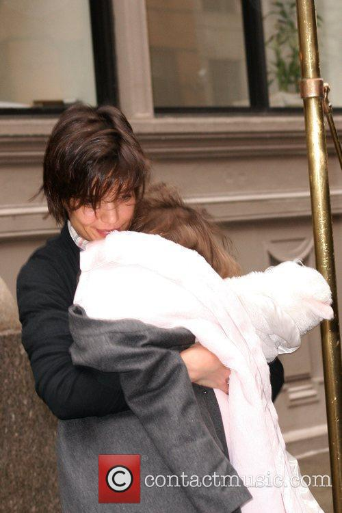 Leaving her Manhattan apartment with her daughter Suri...