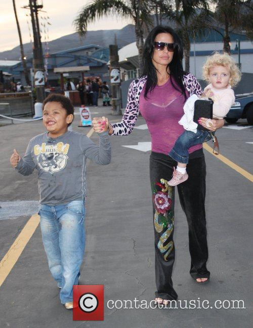 Katie Price, Harvey and Princess Tiaamii Leaving Gladstones Of Malibu 4