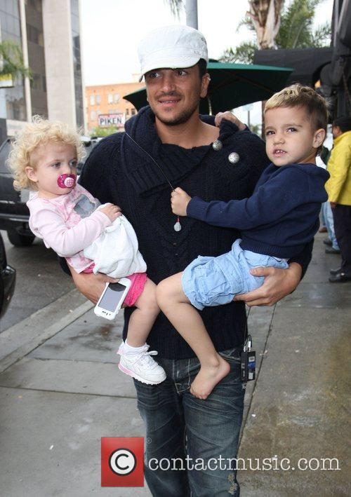 Peter Andre with Junior and Princess Tiaamii outside...