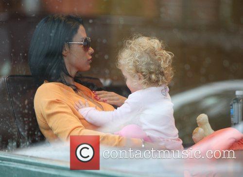 Princess Tiaamii looks down her mother Katie Price's...