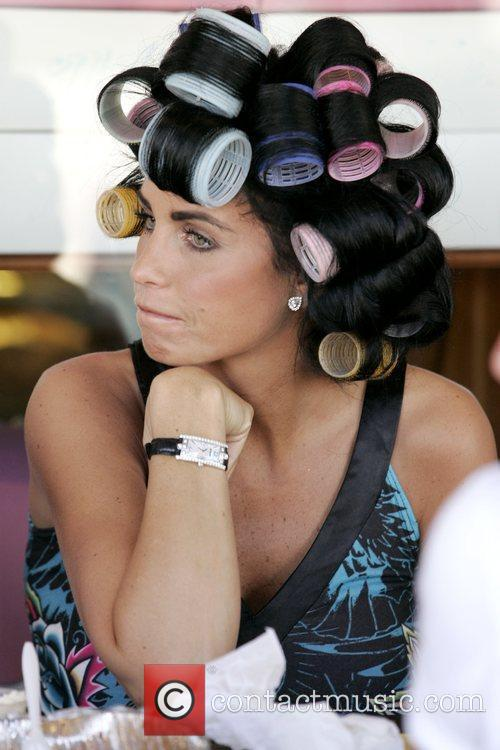 Wearing rollers in her hair while eating lunch...