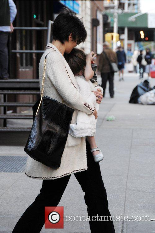 Katie Holmes and her daughter Suri Cruise in...
