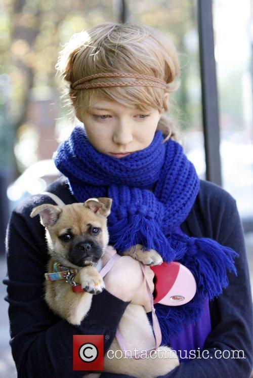 Ekaterina Ivanova takes a little puppy for a...