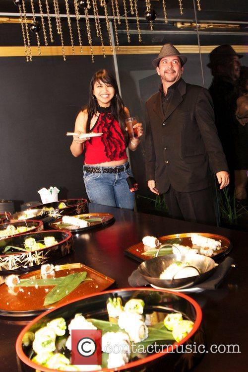 Mika Tan and James Bartholet Keeani Lei celebrates...