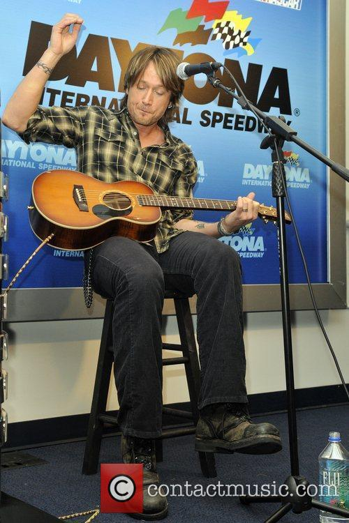 Keith Urban performs at a press conference prior...