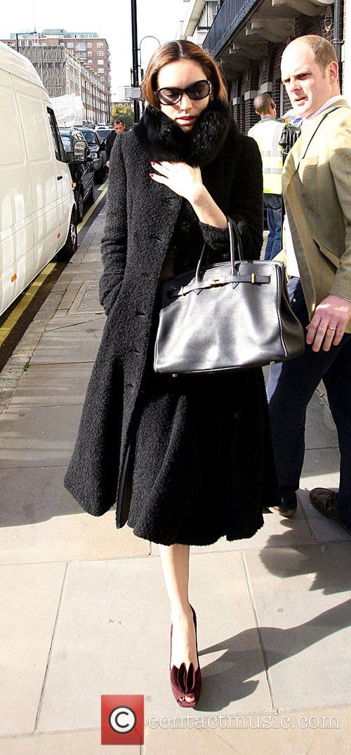 Kelly Brook looks unhappy as she leaves her...