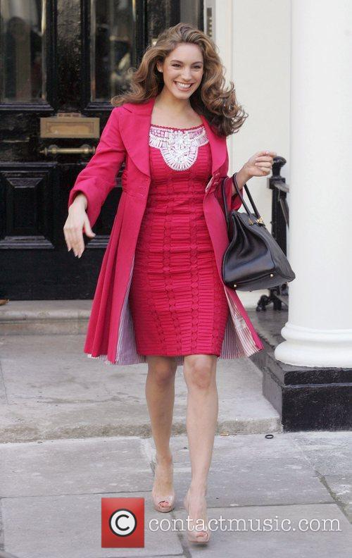 Leaving her house, looking happy despite recently being...