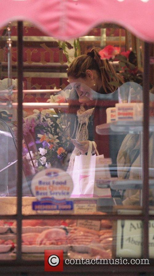 Kelly Brook stops into Kingsland Butcher during a...
