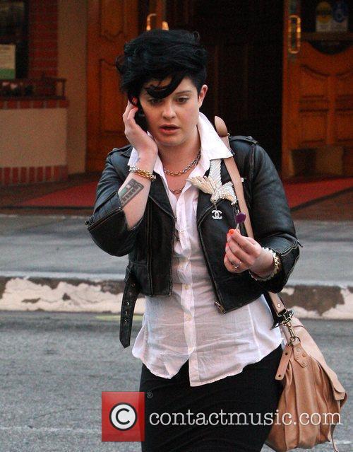 Kelly Osbourne enjoying her lollipop and talking into...