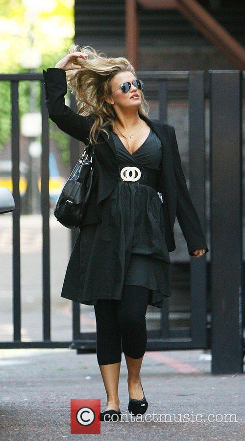 Leaving the London studios after appearing on 'GMTV'.