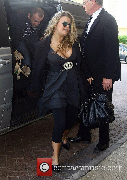 Arrive at their London hotel after Kerry gave...