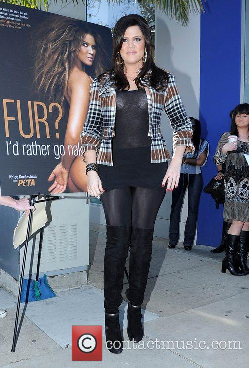 Khloe Kardashian and Billboard 13