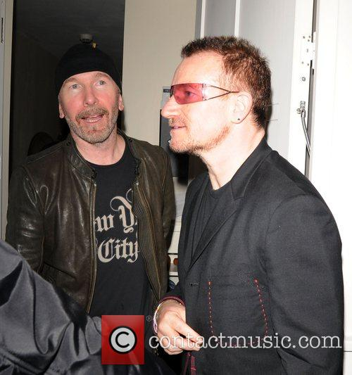 Bono and The Edge leaving a private party,...