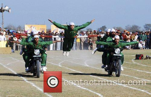 Recruits of Punjab Police Academy, Phillaur, perform a...