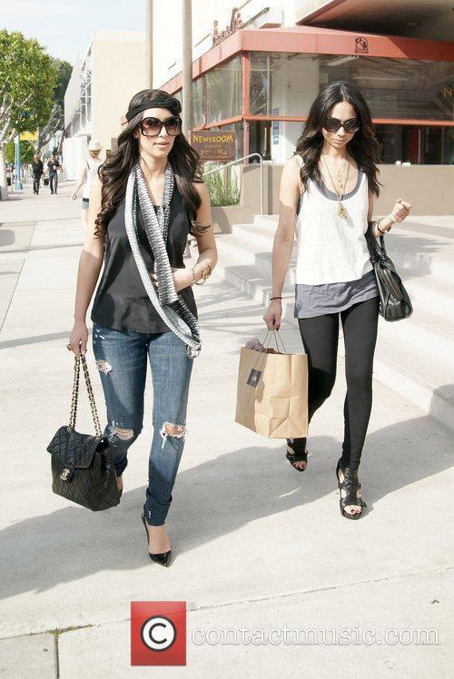 Kim Kardashian wearing a headband while shopping on...