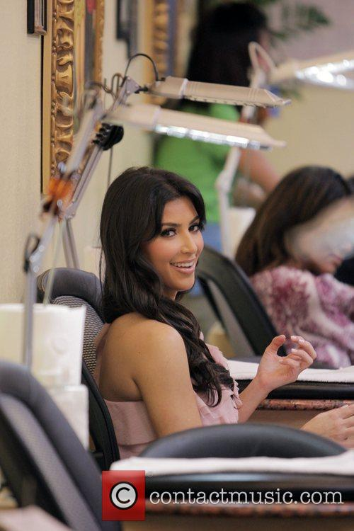 Kim Kardashian  gets a manicure during a...