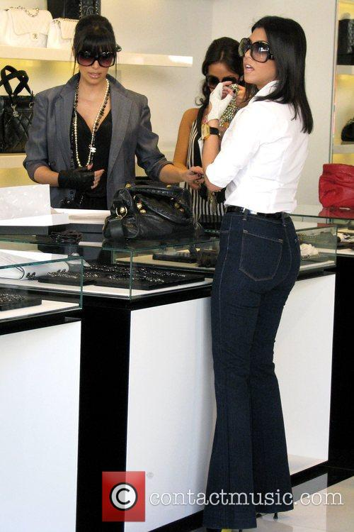 Kim Kardashian, Kourtney Kardashian go shopping at Chanel boutique on Robertson Boulevard