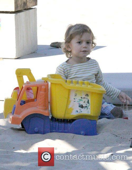 Plays with a toy digger at the park