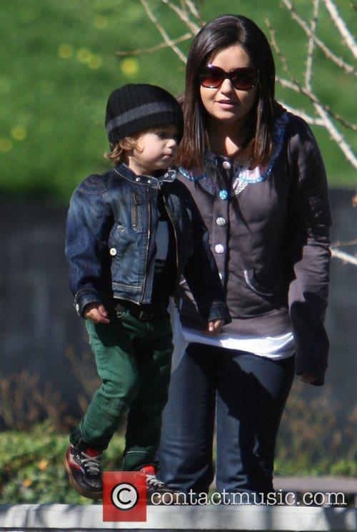 Plays with his nanny at a park in...