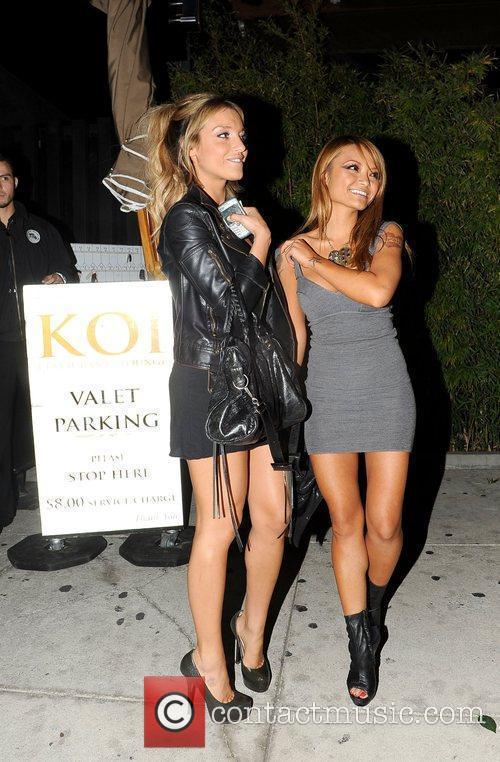 Tila Tequila leaving Koi restaurant and posing for...