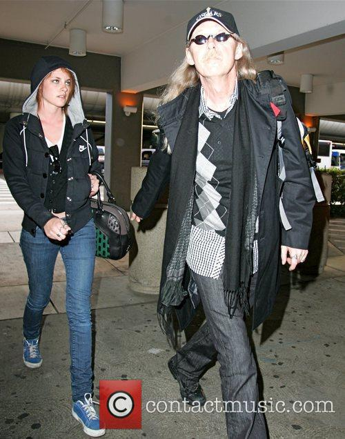 Arriving at LAX with her father, who didn't...