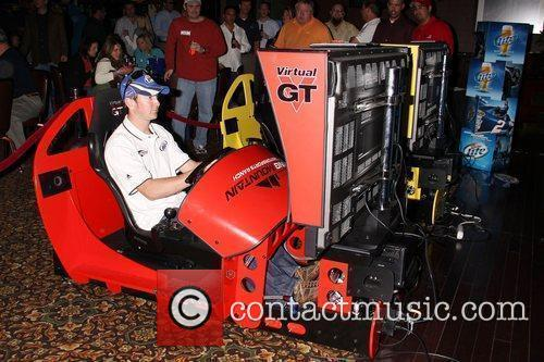 Attends the Kurt Busch Racecar Simulator Challenge event...