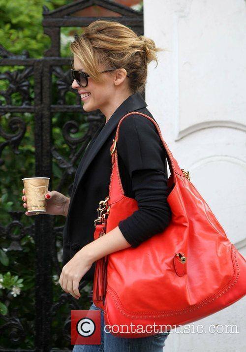 Kylie Minogue carries a coffee as she leaves...