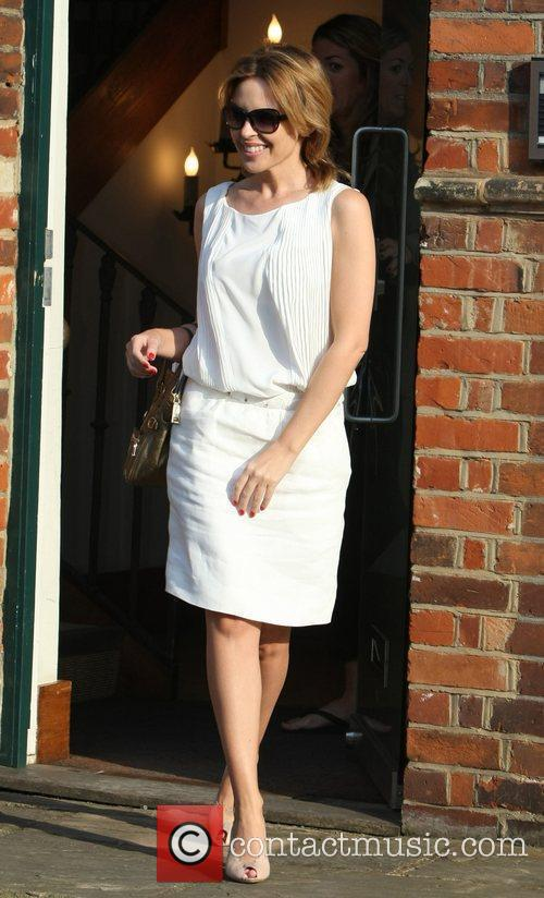 Kylie Minogue leaving her management offices London, England