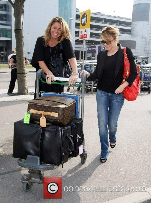 Kylie Minogue arriving at Heathrow airport with her...