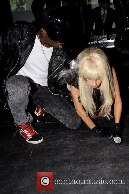 Crawling on the stage during her performance to...