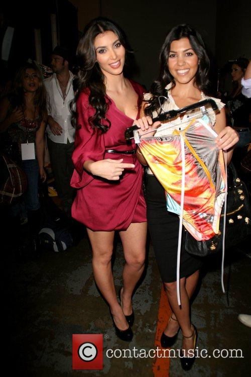 Kim Kardashian and Kourtney Kardashian 1