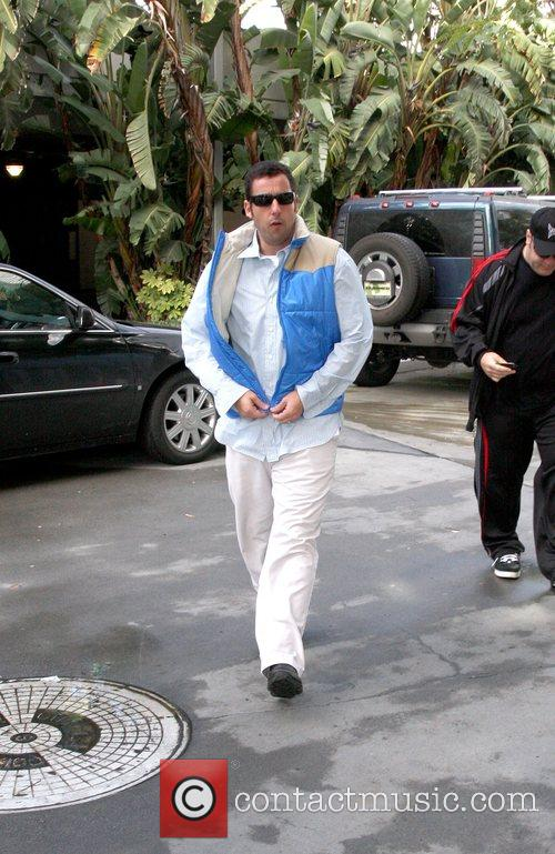 Arrives at the Staples Centre for the NBA...