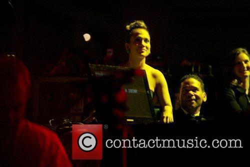 Jennifer Lopez watches her husband Marc Anthony perform...