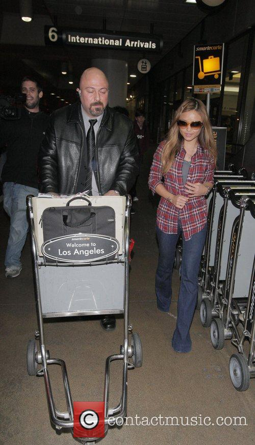 Tila Tequila arriving at LAX airport on New...