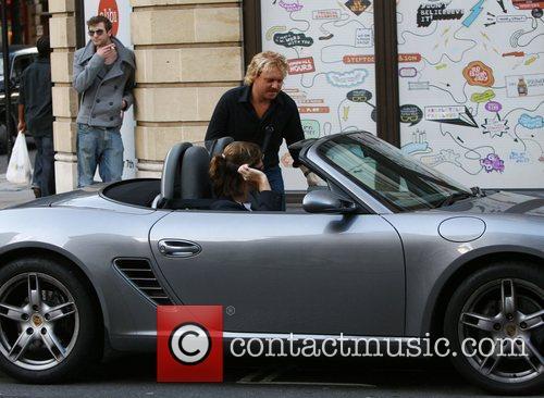 Leigh Francis getting into a Porsche in Central...