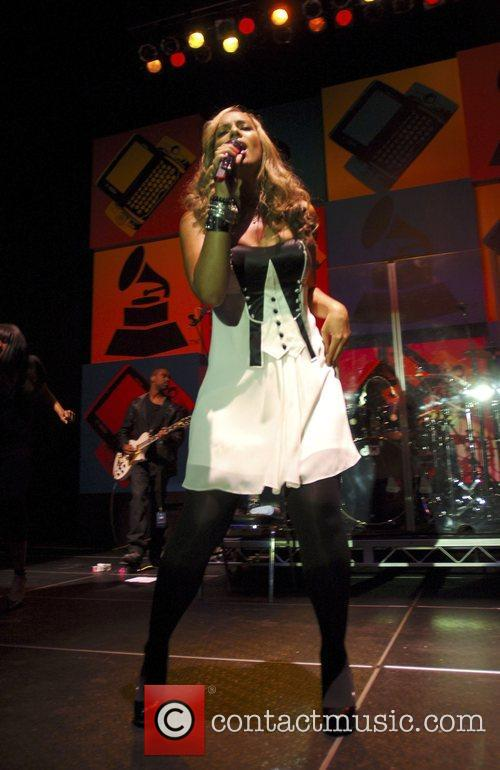 Performing live at the Grammy Celebration Concert Tour...