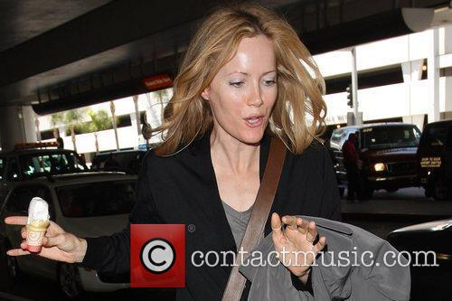 Leslie Mann eating a soft-serve ice cream while...