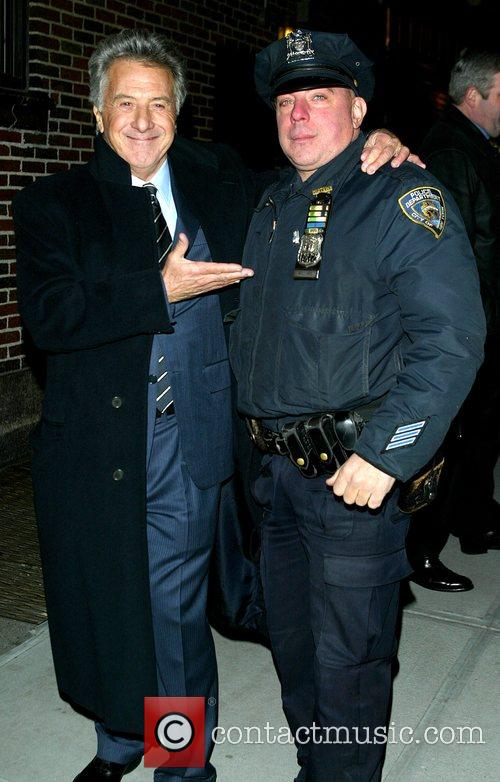 Dustin Hoffman poses with a New York Police...