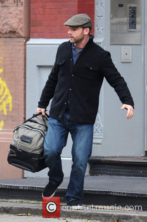 Leaving his Manhattan residence carrying a large bag